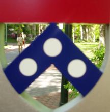 Locust Walk as seen through a Penn's Arms-shaped hole in a sign