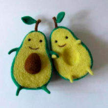 A pair of anthropomorphic avocados holding hands. Really.